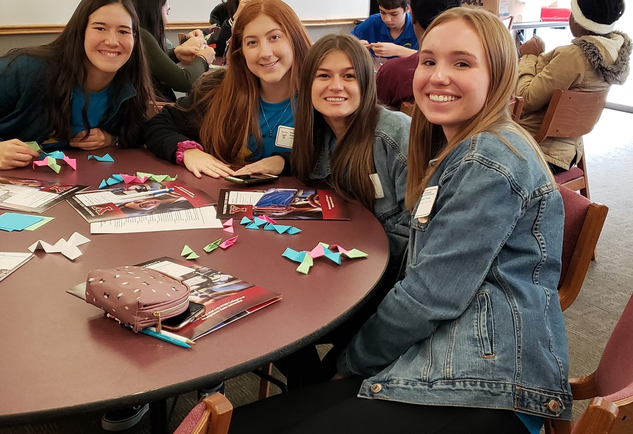 4 Girls at mathfest table