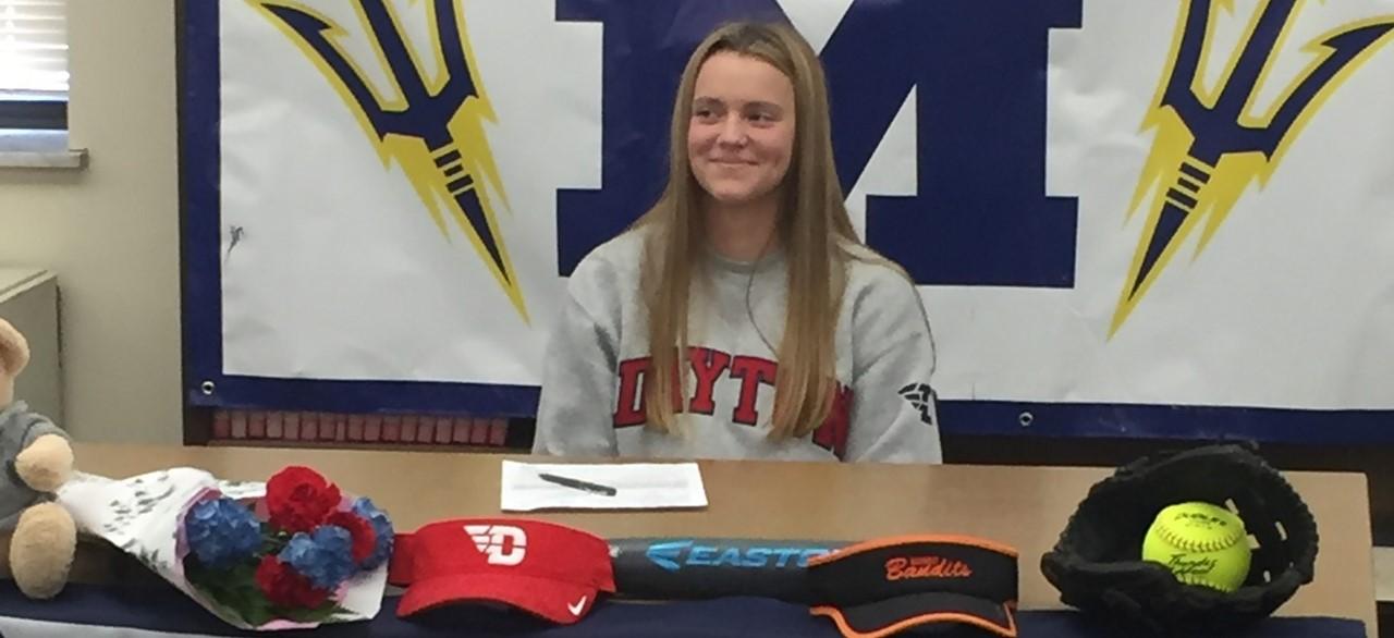 Megan signing with Dayton